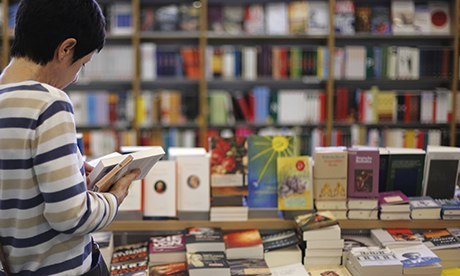 woman reading in books in a bookstore